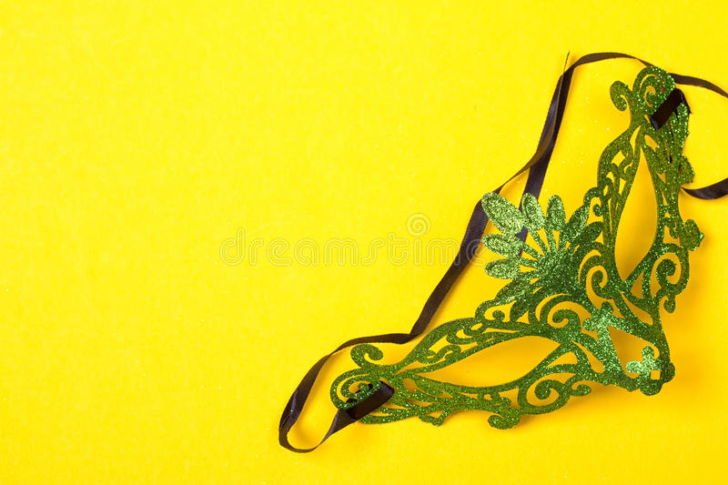 Green mask on yellow background stock images