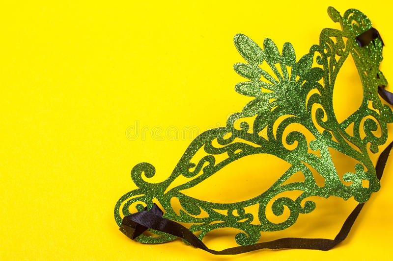 Green mask on yellow background stock photo