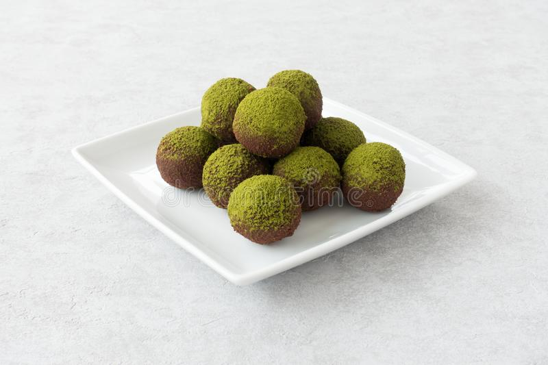 Green Matcha Energy Balls on White Plate royalty free stock images