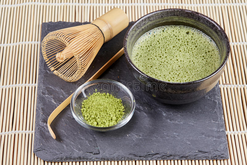 Green matcha powder and tea preparation royalty free stock photography