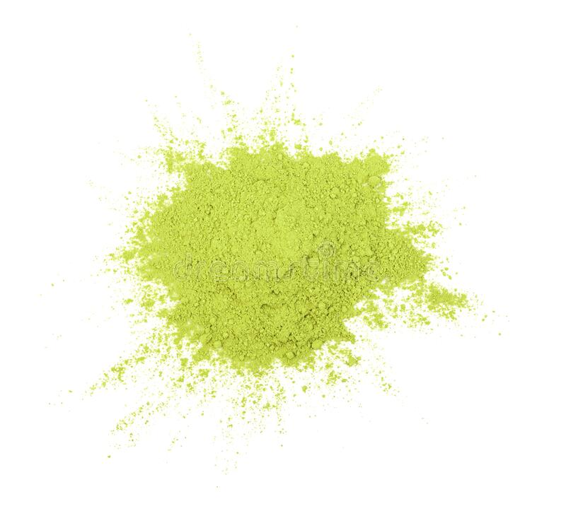Green matcha powder on white background. Matcha made from finely ground green tea powder. royalty free stock photography
