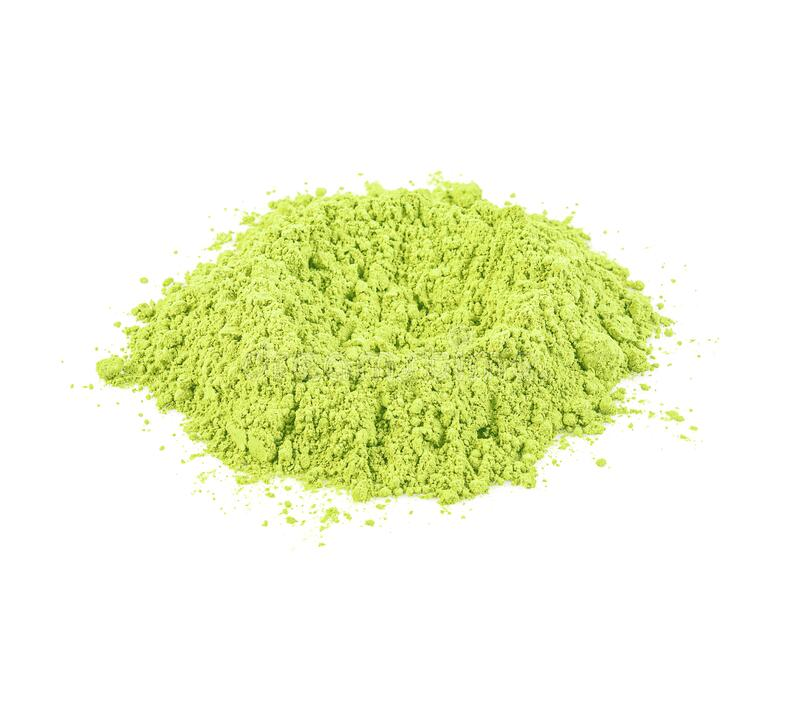 Green matcha powder on white background. Matcha made from finely ground green tea powder stock photos