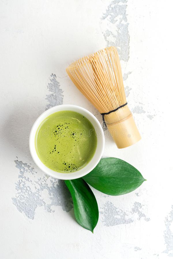 Green matcha tea drink and tea accessories on white background stock photos