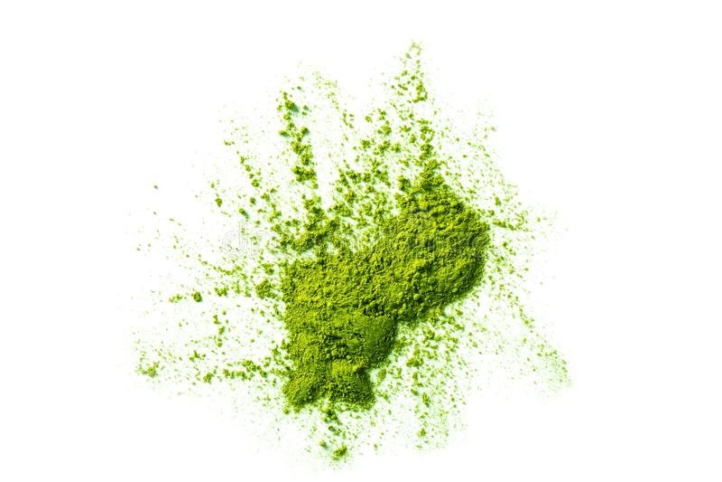 Matcha tea ground erratic form isolated on white. Green matcha tea powder ground in erratic form isolated on white background stock photos