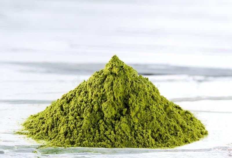 Green matcha tea powder stock photos
