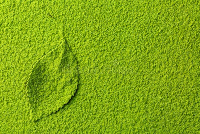 Green matcha tea powder with tea leaf royalty free stock photos
