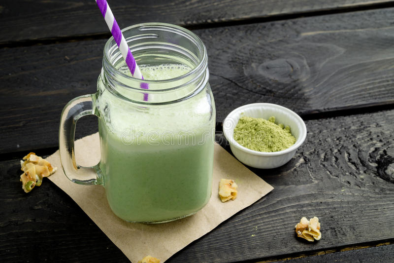Green matcha tea smoothie. Smoothie made with powdered green tea (also known as matcha). Not only is this green smoothie delicious, it's also packed with stock photo