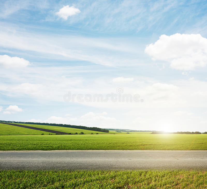 Green meadow and road stock image