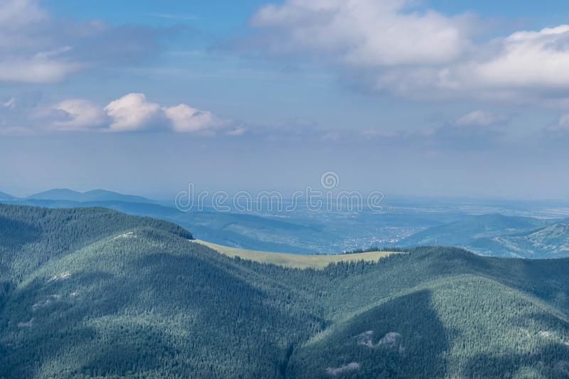 Green meadow on top of the mountain stock photography