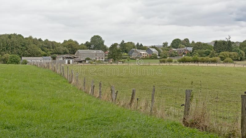 Fields with farms and houses and forests in the Wallonian countryside royalty free stock photo