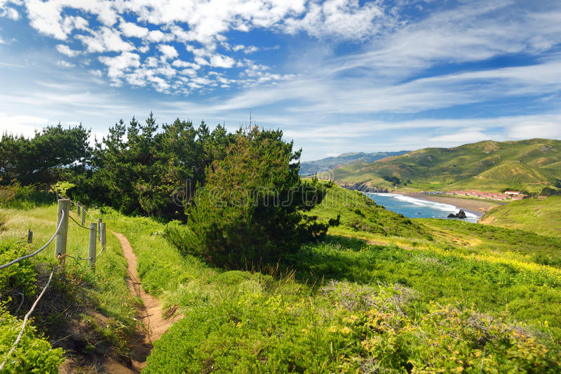 Green meadows and view of the Pacific Ocean at Point Bonita, California royalty free stock photography