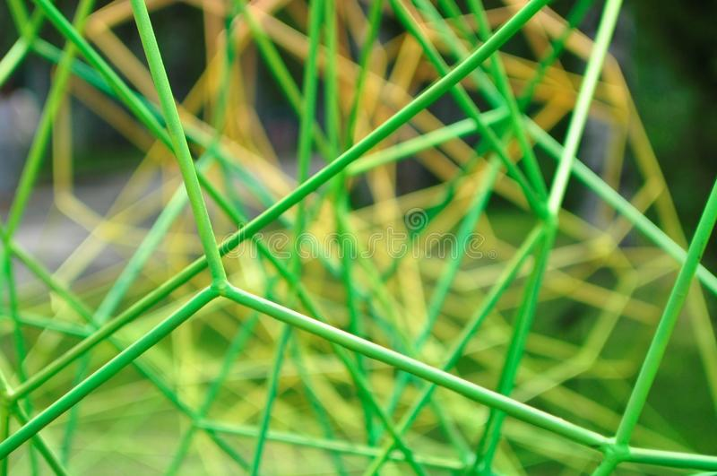 Green metal bars. In the form of cobwebs stock image
