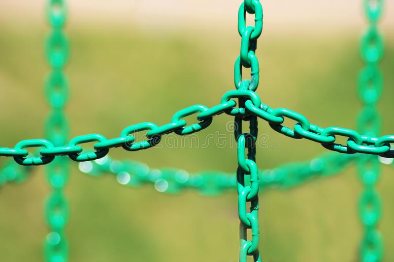 Green metal chain for protection stock image