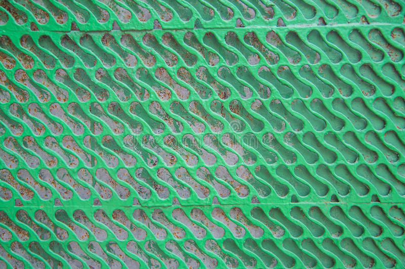 Green Metal fence. Detail of an old metal fence stock photography