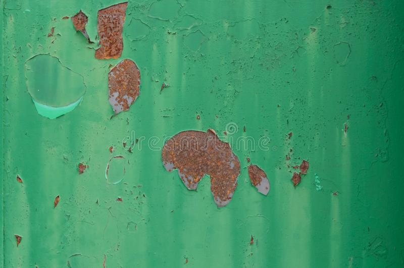 Rusty Paint Peeling Old Green Vintage Metal Door Texture for background and design art work. Green Metal Paint Peeling Old Vintage Texture for background and stock photo