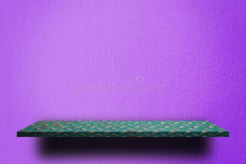 Green metal shelf on Purple wall stock photos