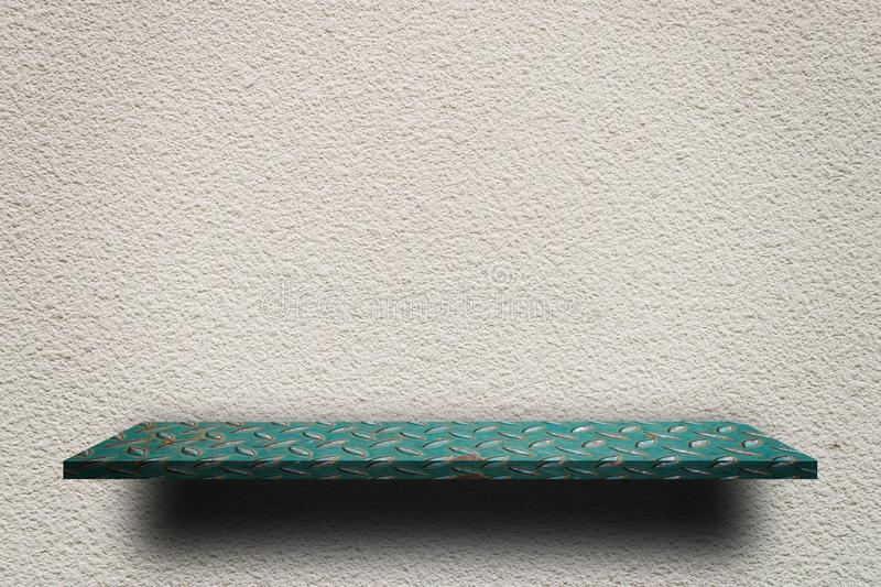 Green metal shelf on Rough gray cement wall stock photos