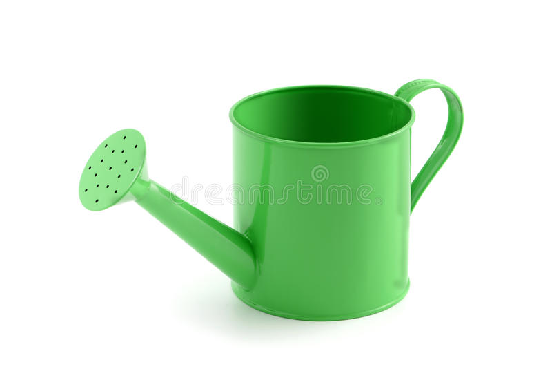 Green metal water can on isolated background stock photography