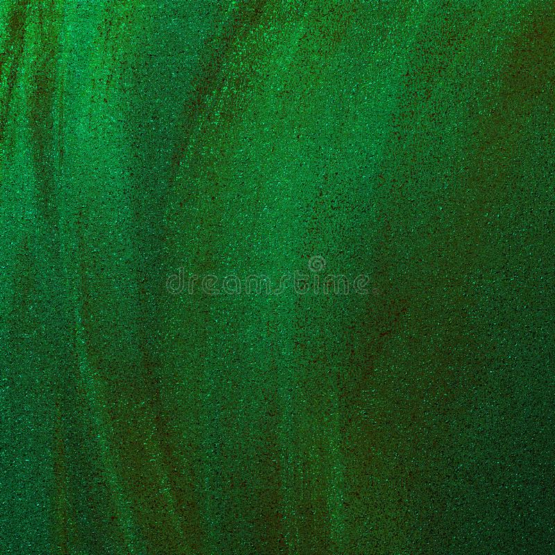 Green metallic sand textured abstract background. Tinted brush strokes artwork. Glitter scattered on grungy rough surface. royalty free stock photos