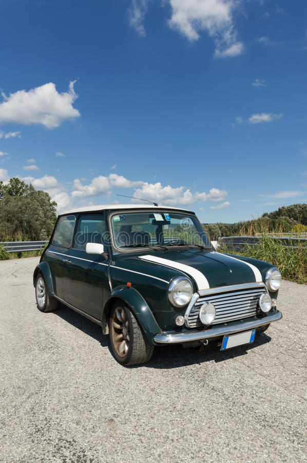 Green Mini Cooper. A view of a Limited Edition Mini Cooper parked on a sunny day royalty free stock photos