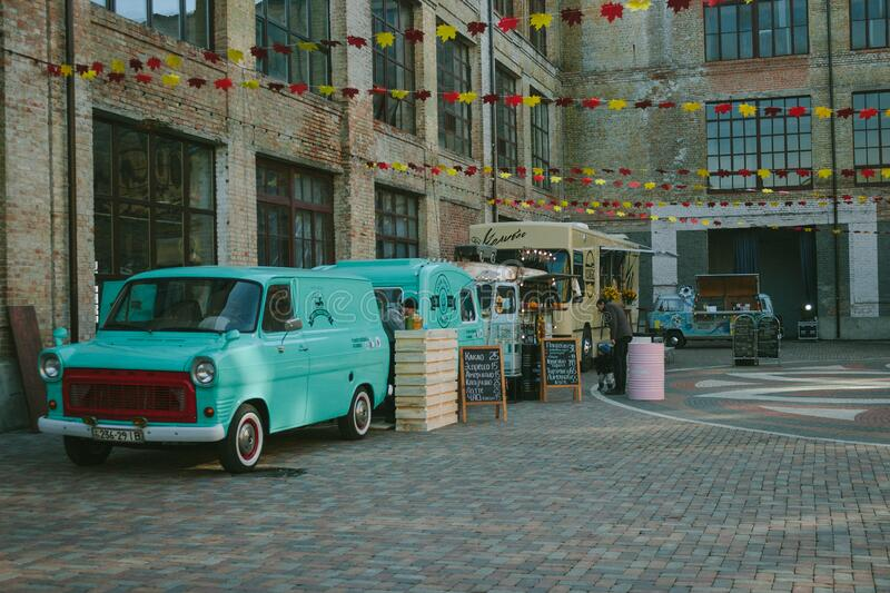 Green Minivan Near Brown Wooden Crate And Brown Food Truck Free Public Domain Cc0 Image
