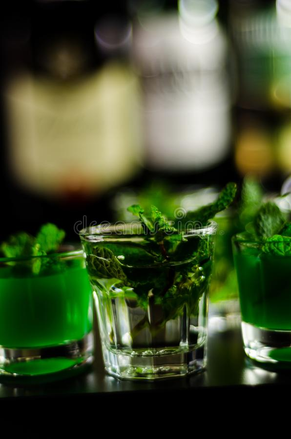 Green mint liqueur, refreshing drink with fresh mint, energizing. Cocktail, party night stock photo