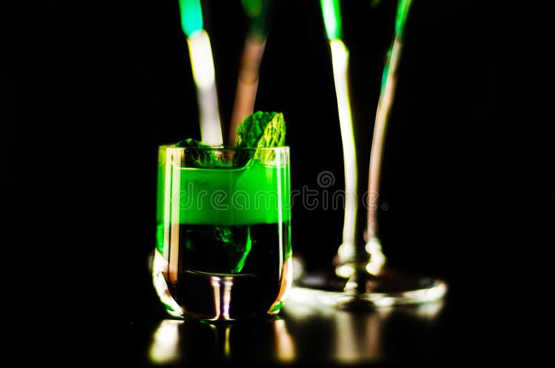 Green mint liqueur, refreshing drink with fresh mint, energizing. Cocktail, party night stock photos