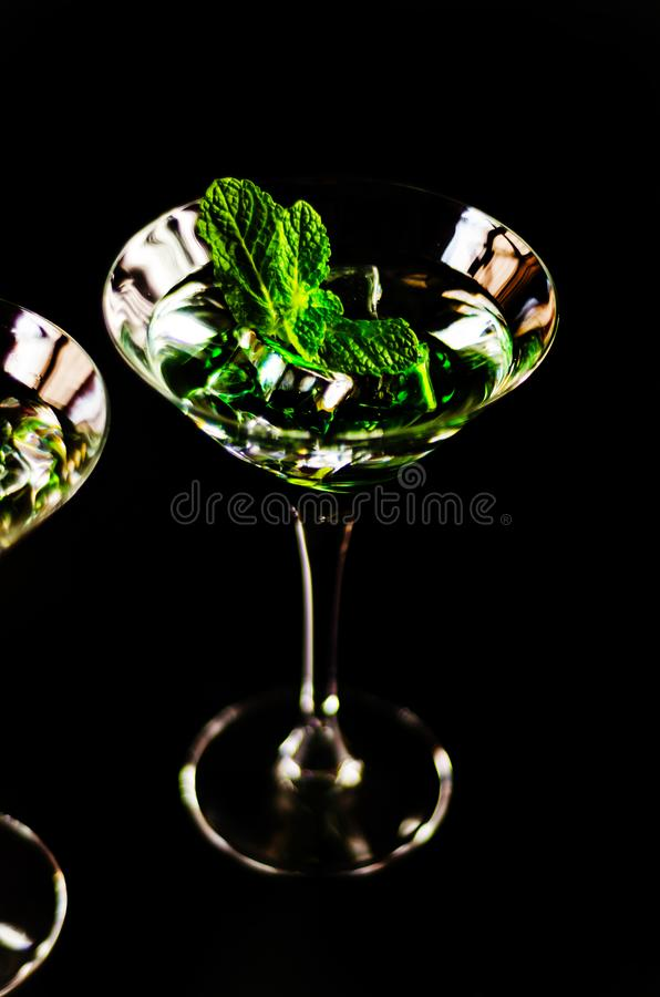 Green mint liqueur, refreshing drink with fresh mint, energizing. Cocktail, party night stock images