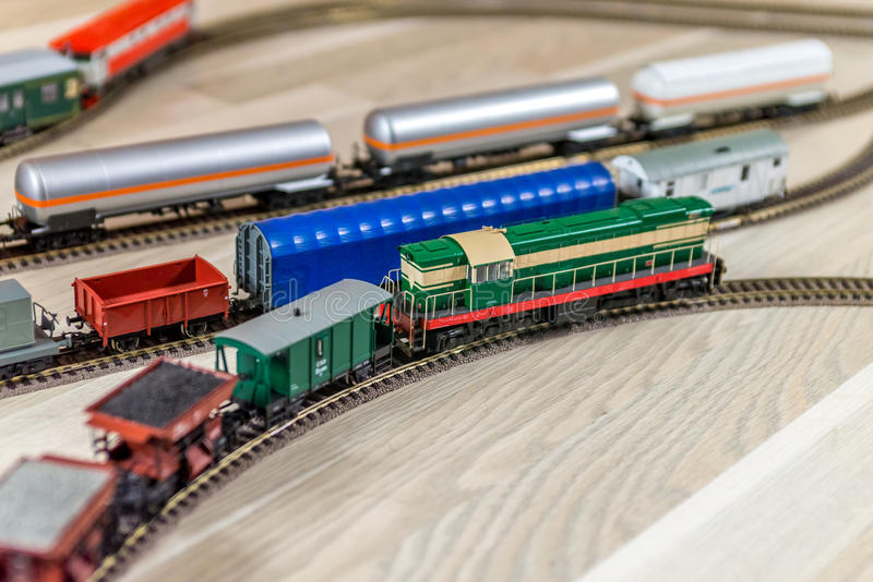 Green model diesel engine pull freight train stock photography