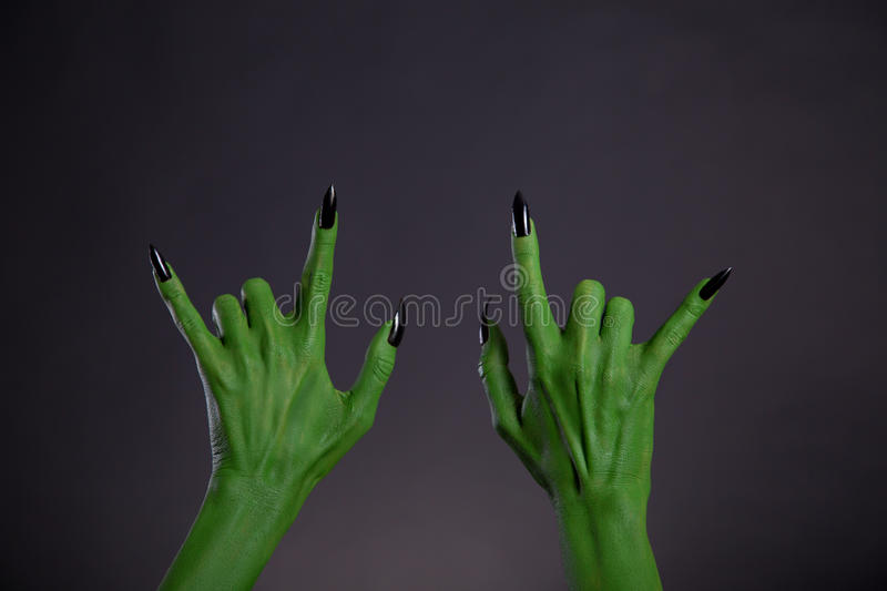 Green monster hands showing heavy metal gesture. Halloween theme royalty free stock images