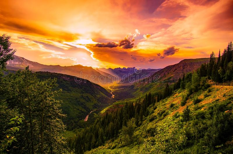 Green Mountain Near River Under Cloudy Sky during Daytime stock image