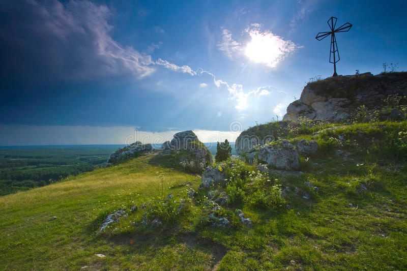 Green mountain peak with cross royalty free stock photography