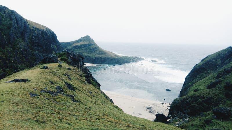 Green Mountain Ruins Near Seashore royalty free stock photo