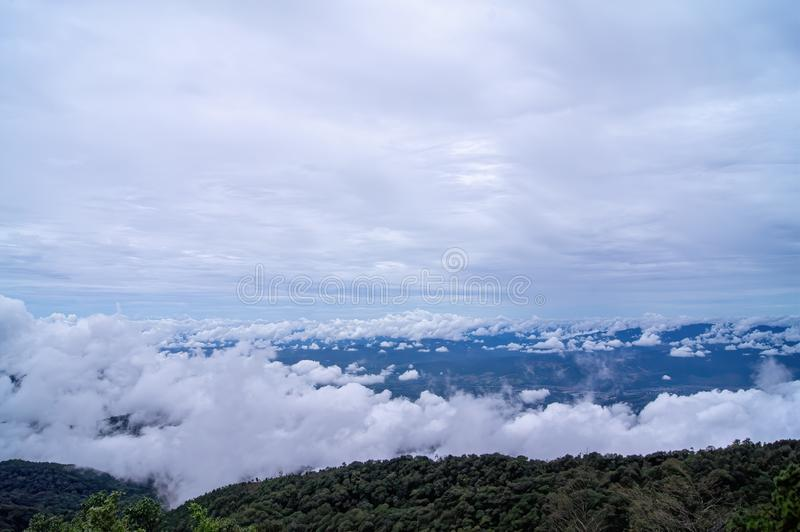 Green mountain scenery; fog in the mountains a. The sky is covered with white clouds. Green mountain scenery. fog in the mountains a. The sky is covered with royalty free stock photo