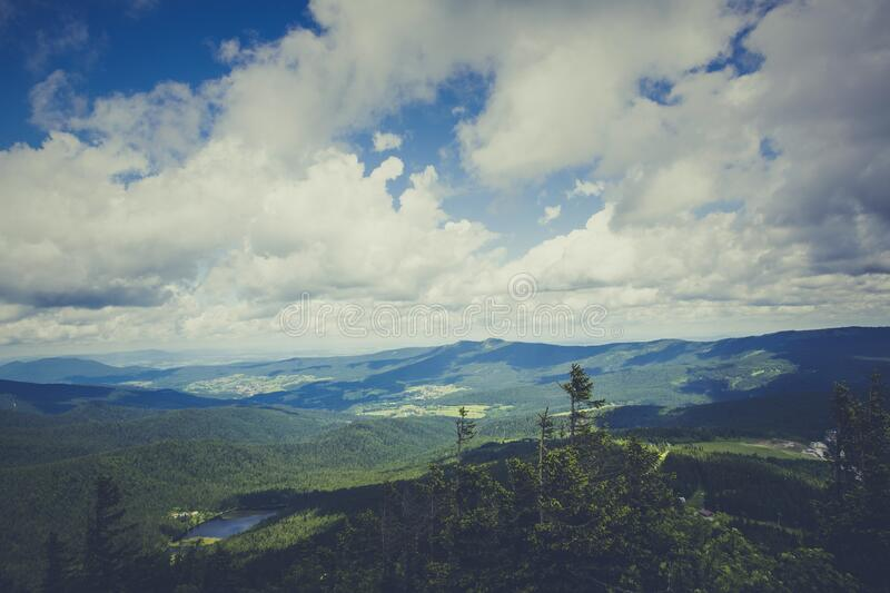 Green Mountain Under Cloudy Sky during Daytime stock photo
