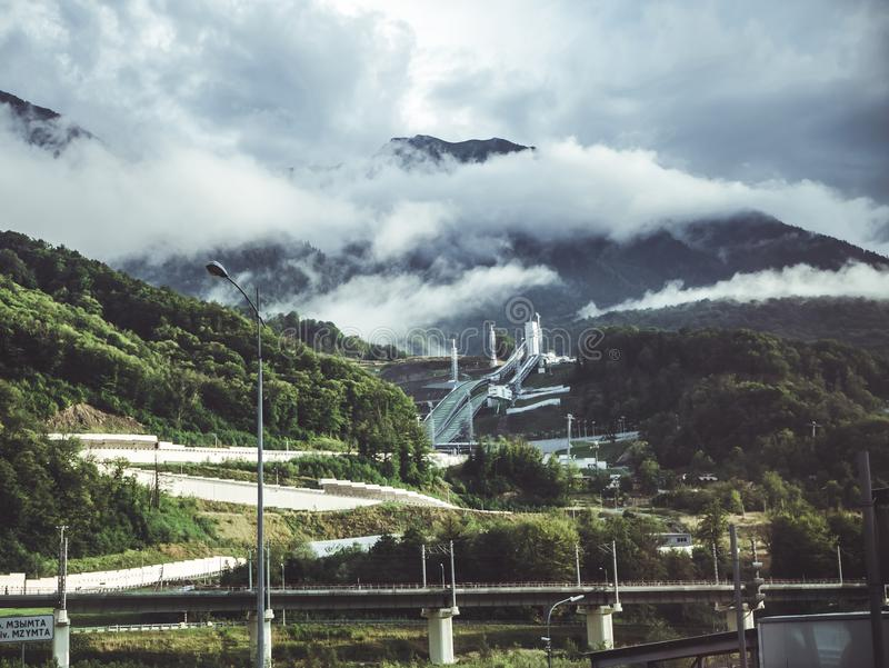 Green Mountain Under White Clouds stock photo