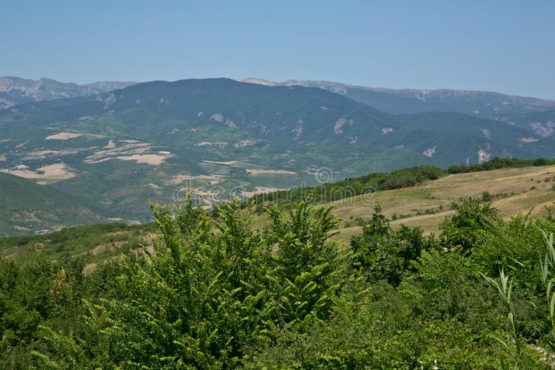 Green mountains covered with forest on the blue sky background. Panorama .Mountain green valley landscape. Beautiful mountain stock photos