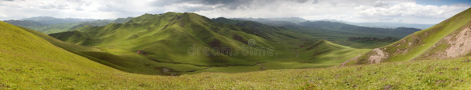 Green mountains - East Tibet - Qinghai province - China. Panaramic view of green mountains - East Tibet - Qinghai province - China stock image