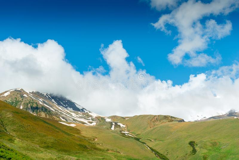 Green mountains with snow caps in June, Caucasus. Georgia royalty free stock photo