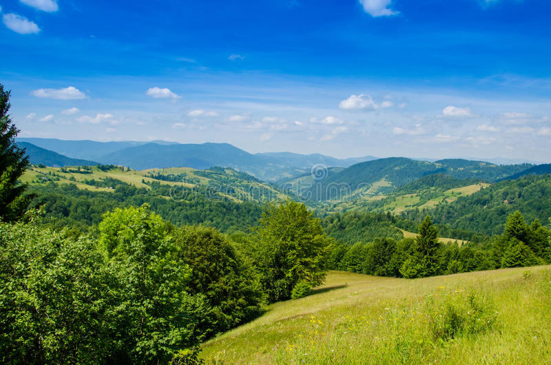 The green mountains. On the way to the green mountains at dawn on a summer day royalty free stock photos