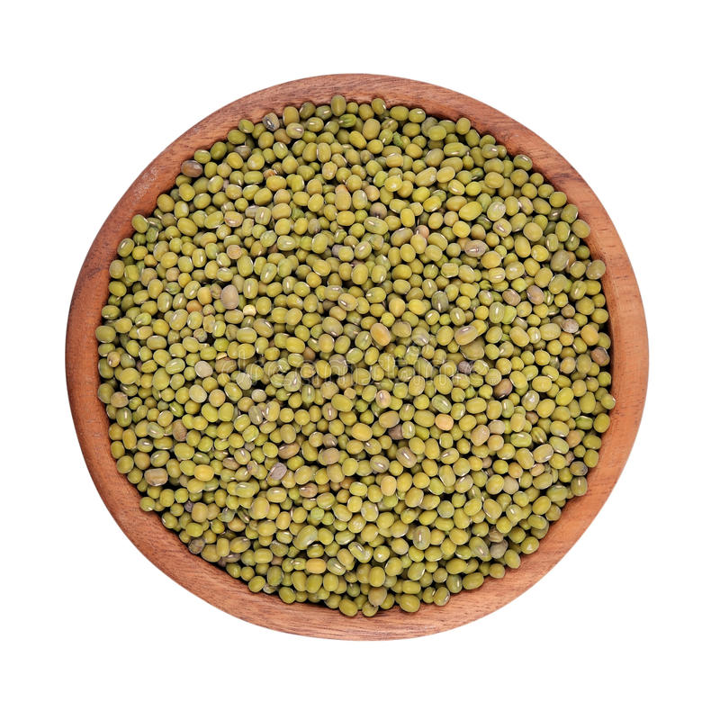 Green mung beans in a wooden bowl on a white background stock photo
