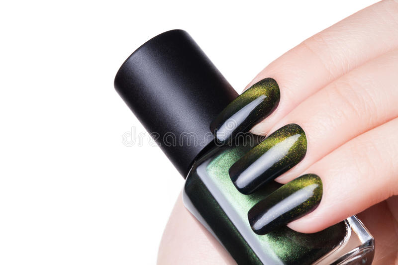 Green nail polish. stock photography