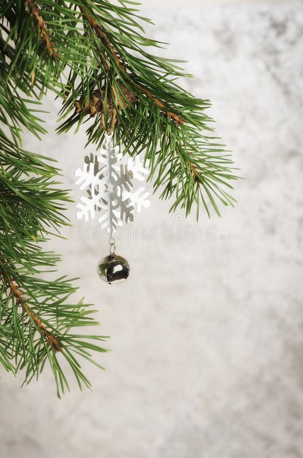 Green natural Christmas tree and Christmas balls with snow on a stock photography
