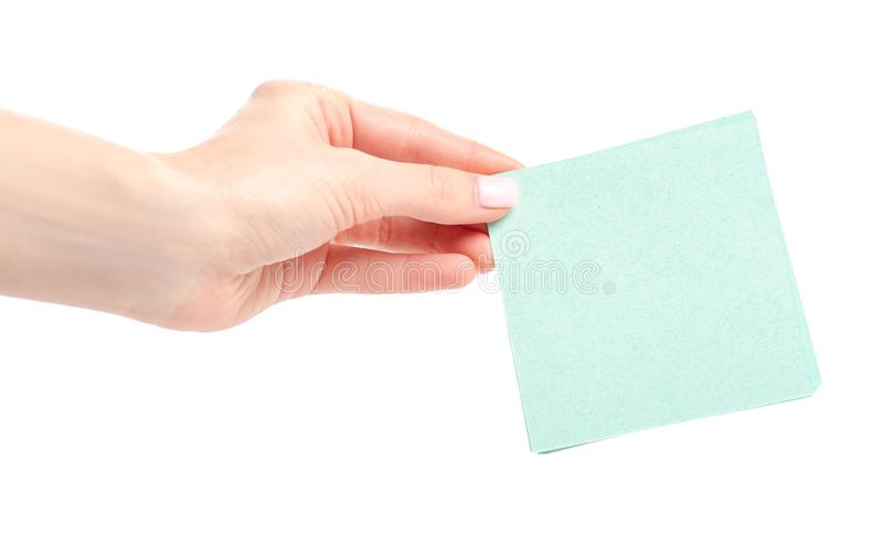 Green note paper in hand. On white background isolation royalty free stock images