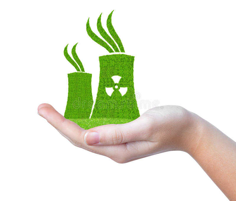 Green Nuclear power plant icon in hand. Isolated on white stock photo