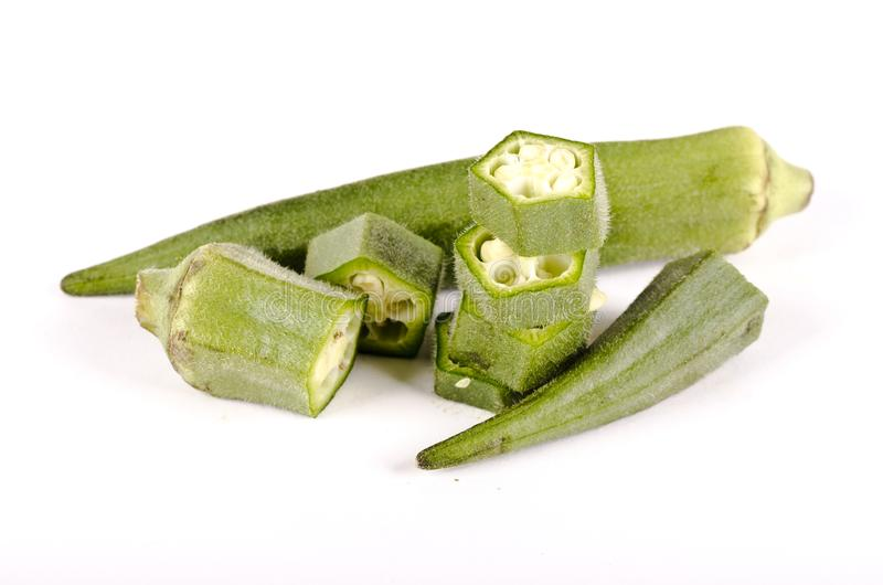 Healthy green ocra vegetable cut and whole stock photos