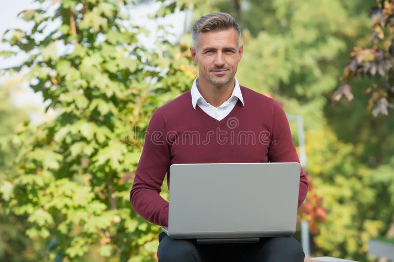 Green office. Inspiring innovations. Businessman inspired by nature guy feel powerful to change world. Man inspired hold stock images