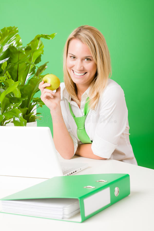Green office woman smiling hold apple plant royalty free stock photo