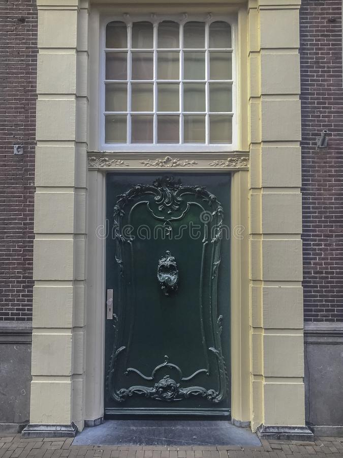 Green old Dutch door of a mansion stock images
