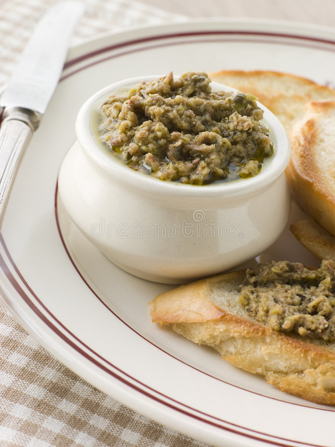 Green Olive Tapenade with toasted baguette royalty free stock photo